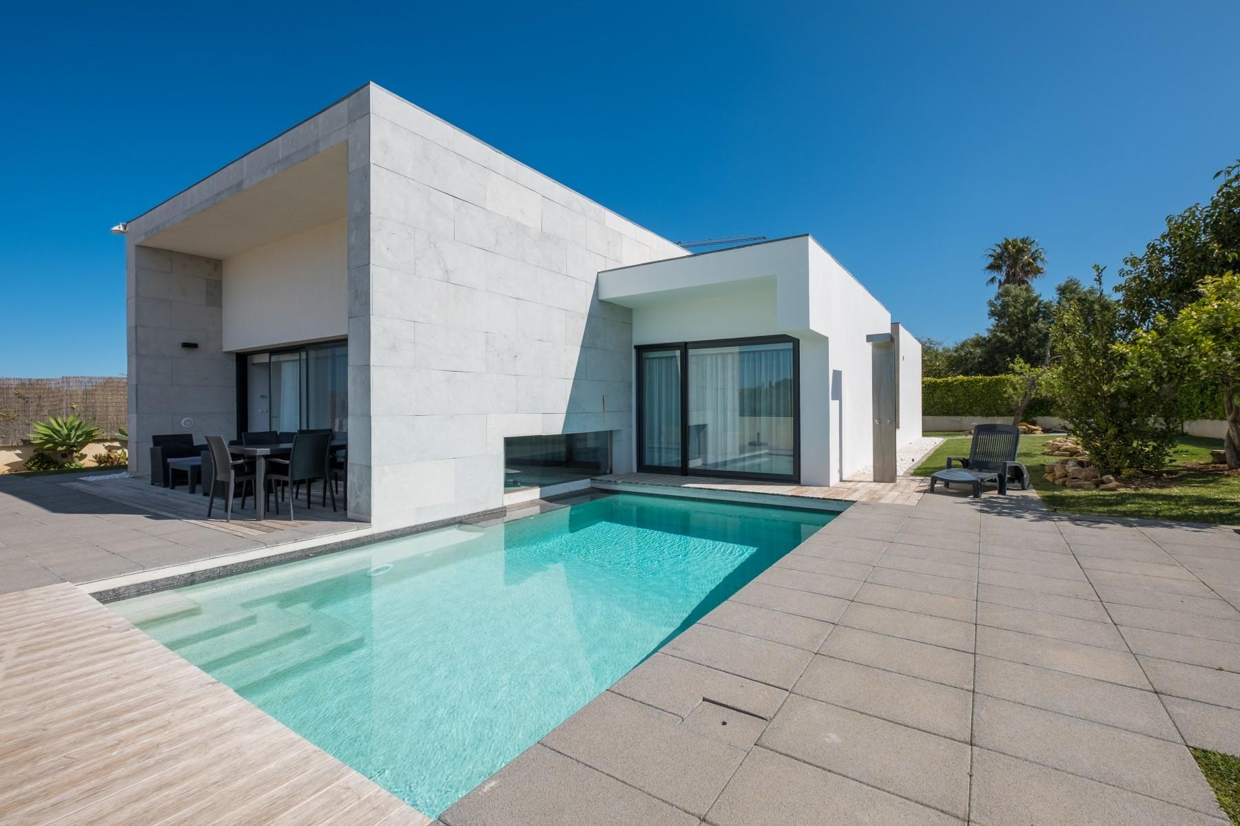 Villa/Dettached house in Luz - Villa with free Wi-Fi   A/C   private pool   garden   tennis court   near beach   sea view [RLUZ17]